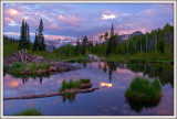 Alpine beaver pond at sunset