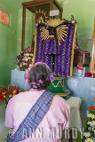 Lady praying to the Lord of Esquipulas