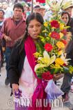 Pilgrim carrying floral bouquet