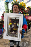 Pilgrim carrying Lord of Esquipulas in shadow box