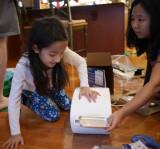 P1150924 Sunny Explains Easy Bake Oven to Kira