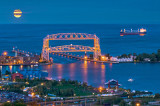 96.7 - Duluth Aerial Lift Bridge And Harbor View With Moonrise