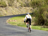 girl cycling up Sugarloaf