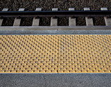 Step back behind the yellow line.