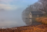 Llyn Dinas boat house in the mist.