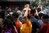 Devotee with milk pot on the head in the procession