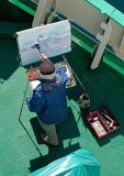 Artist on the foredeck