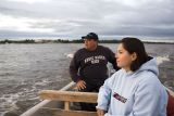 Boat trip at dusk on the Moose River