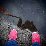Took my walk today...stopped to play in a puddle.