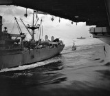 Loading stores from cargo ship on to USS Randoplh CVA 15
