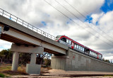 An  Austin, Tx  Capital Metro light rail car moves up an incline