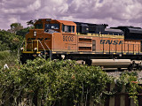 BNSF Engine 9203 rolls through Bellville, TX  with freight cars in tow.