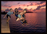kids enjoying a sunset dip in the ocean