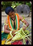 Yapese girl weaving a basket