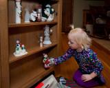 Grace helping arrange Grandma's snowmen