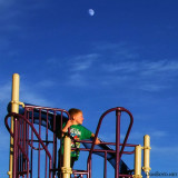 November 2012 - Kyler on the playground with the moon rising in the east at Peterson Air Force Base, Colorado