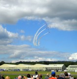 THE RED ARROWS SWEEP IN