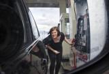 _SDP3847pb.jpg Sheryl Filling the BMW at Costco River Cree