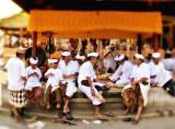 Men & boys gather inside a temple