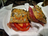 Prosciutto and tomato panino with sunflower seeded bread .. 4927
