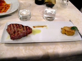 Veal steak  with side of cooked apple with fennel seeds .. 6352