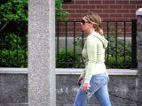 Woman walking near apartments