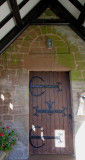 saxon doorway with sundial above