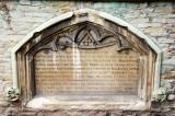 memorial in east wall....