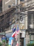 Bangkok Electricity with Flags, Signs and a Campaign Poster