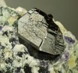 Cassiterite, glossy sharp 38 mm twinned crystal group. Mian Yan, Sechuan, China.