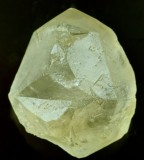 Calcite twin, (twin plane {00.1}), 26 mm. Hollandtwine Mine, Dirtlow Rake, Castleton, Derbyshire, UK.