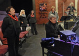 THE CHORUS WARMING UP BEFORE A PERFORMANCE