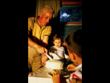 Dad cutting birthday cake