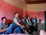 Group inside a local house taking a tea