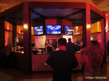 Fans watching Furthur on the bar's video screens