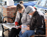 Conferring with the festival guide and making a film-watching gameplan