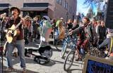 Austin Quattlebaum entertains via pedal-power, at the end of the Climate Action parade
