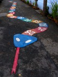 An invitation to play Hopscotch or Snakes and  Ladders