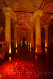 Fish in red light with marble columns of the underground Basilica Cistern of Istanbul Turkey