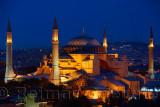 Night lights on Hagia Sophia and Sultan Selim Murat Turbesi at twilight in Istanbul Turkey