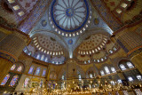 Interior of the Blue Mosque Istanbul Turkey with Iznik tiles and stained glass windows