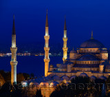 Three lit minarets of the Blue Mosque at dusk on the Bosphorus Sultanahmet Istanbul Turkey