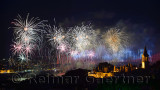 Bright Republic Day fireworks on the Bosphorus with Bridge lights and Topkapi and Dolmabahce Palaces Istanbul