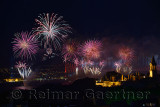Red Republic Day fireworks on the Bosphorus with Bridge lights and Topkapi and Dolmabahce Palaces Istanbul
