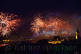 Republic Day fireworks over the Boshporus with lit Topkapi and Dolmabahce Palaces Istanbul Turkey