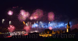 Light show on the Bosphorus Bridge with fireworks and night lights on Topkapi Palace Istanbul