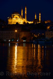 Lights of Suleymaniye Mosque largest in Istanbul reflected before dawn in waters of the Golden Horn