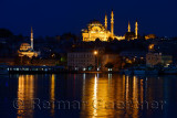Rustem Pasha and Suleymaniye Mosques in Istanbul reflected before dawn in waters of the Golden Horn