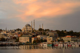 Rustem Pasha and Suleymaniye Mosques with golden sunrise on the waters of the Golden Horn Istanbul