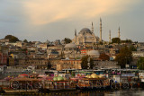 Rustem Pasha and Suleymaniye Mosques at sunrise with tour boats docked on the Golden Horn Istanbul